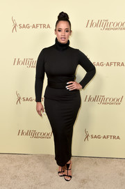 Dascha Polanco cut a shapely figure in a body-con black turtleneck dress at the Hollywood Reporter and SAG-AFTRA Emmy nominees night.
