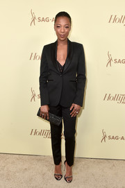 Samira Wiley styled her suit with a pair of embellished sandals.
