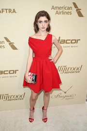 Natalia Dyer looked captivating in a red off-one-shoulder cocktail dress by Preen at the Hollywood Reporter and SAG-AFTRA Emmy nominees night.