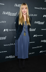 Dakota stuck to a more casual look with this draped navy dress, which she paired with a velvety blue blazer.