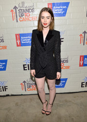 Lily Collins was sexy-glam down below in crystal-studded black sandals by Aperlai Paris.