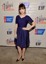 Zooey Deschanel chose a vintage blue cocktail dress with a tight-fitting wrap bodice for the Hollywood Stands Up to Cancer event.