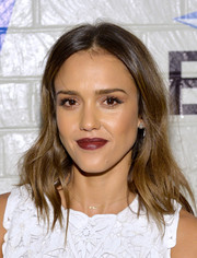 Jessica Alba looked almost goth with her dark red lipstick.