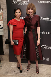 Anna Wintour chose a burgundy and black dress in her signature fit-and-flare silhouette for the 35 Most Powerful People in Media event.