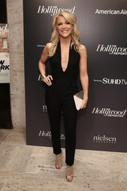 Megyn Kelly attended the 35 Most Powerful People in Media celebration wearing a black jumpsuit with a daring deep-V plunge.