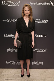 A dusky gold satin clutch finished off Mamie Gummer's minimalist-elegant ensemble.