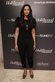 Padma Lakshmi paired her casual pants with a fur-sleeve top for a dressier finish.