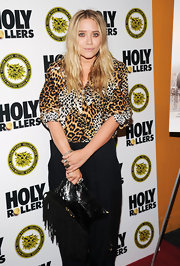Mary-Kate shows her wild side in a fierce leopard-print blouse.