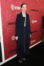 Rebecca Hall arrived for the premiere of 'Homeland' season 8 wearing a long black trenchcoat.