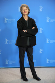 Charlotte Rampling completed her menswear-inspired ensemble with black leather lace-ups.