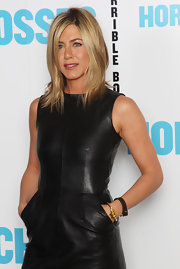 Jenn Aniston looked sexy and glamorous in a black leather mini dress that she paired with black strappy heels and sleek locks.