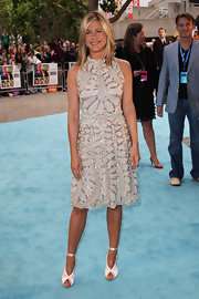 America's sweetheart Jennifer Aniston lookd chic and glamorous at the 'Horrible Bosses' premiere wearing a white and silver Valentino cocktail dress. She finished off the look with exquisite heels and sleek blonde locks. Has this gorgeous star ever had a bad hair day?