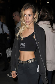 Alice exposed her waspy waist by layering a black hoodie over a tight midriff tank on a night out in London.