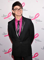 Christian Siriano looked edgy and dapper in this leather clad blazer and hot pink shirt.