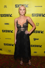 Maika Monroe complemented her dress with strappy black heels by Giuseppe Zanotti.