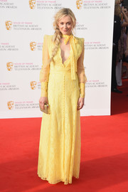 Fearne Cotton brightened up the red carpet with this yellow lace gown during the House of Fraser BAFTA TV Awards.