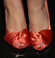 Kimberly Cole arrived at the MTV Video Music Awards after party with a hot coral polish that paired beautifully with her juicy orange satin pumps.