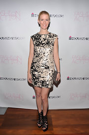Alex dons a black-and-beige sequined print cocktail dress with fierce gladiator sandals.