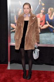 Tavi Gevinson layered a tan teddy bear coat over a little black dress for the New York premiere of 'How to Be Single.'