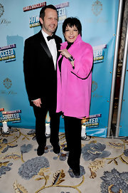 Liza Minnelli posed for a shot at a Broadway opening night wearing a pink trenchcoat.