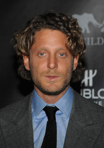 Lapo Elkann kept it natural with a tousled curly 'do at the Hublot and African Wildlife Foundation auction dinner.