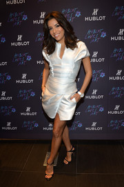 Eva Longoria was modern-glam in a structured white mini dress during the Hublot Art Basel event.