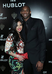 Vanessa Bryant accessorized with a very feminine red satin clutch during Hublot's celebration.