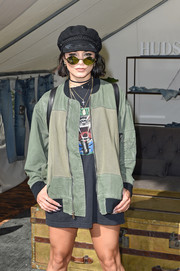 Vanessa Hudgens went for a tough vibe in a bulky green bomber jacket at the Hudson Jeans FYF Fest Style Lounge.