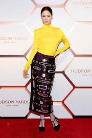 Coco Rocha teamed her top with an embellished purple pencil skirt.