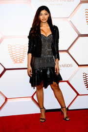 Danielle Herrington toughened up her frock with a black leather jacket.