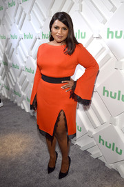 Mindy Kaling cut a sophisticated figure in a red ADEAM dress with contrasting lace trim at the Hulu '19 brunch.