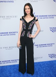 Lydia Hearst displayed her slim figure in a fitted black jumpsuit with an embroidered bodice at the 2018 To the Rescue! Los Angeles Gala.