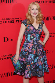 Patricia Clarkson paired a metallic blue clutch with her print dress for a totally colorful look during the 'Catching Fire' NYC premiere.