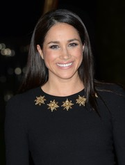 Meghan Markle opted for a simple straight hairstyle when she attended the 'Catching Fire' London premiere.