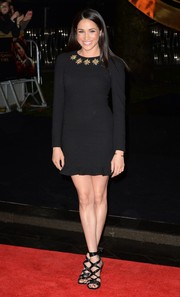 Meghan Markle kept it classic in an Alexander McQueen LBD with an embellished neckline during the 'Catching Fire' London premiere.