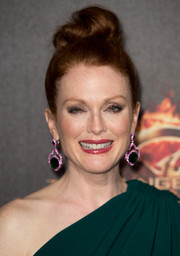 Julianne Moore amped up the glamour with a pair of multicolored dangling gemstone earrings by Chopard.
