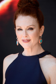 "Julianne Moore wore a delightful pair of color-block dangling earrings to the 'Hunger Games"" Mockingjay Part 1' photocall."