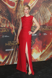 Elizabeth Banks sizzled in a fiery red Saint Laurent gown at 'The Hunger Games: Mockingjay Part 1' preview event in Berlin.