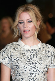 Elizabeth Banks served up some Brigitte Bardot-inspired sexiness with this messy updo at the 'Hunger Games: Mockingjay Part 2' UK premiere.
