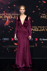 Jennifer Lawrence made a grand entrance at the 'Hunger Games: Mockingjay - Part 2' world premiere in a wine-colored Christian Dior Couture gown with a plunging neckline and shoulder cutouts.