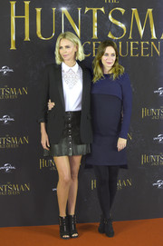 Emily Blunt teamed her dress with a pair of black tights.