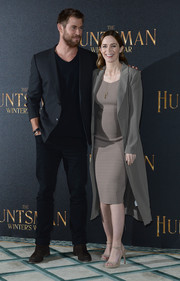 Emily Blunt layered a gray ST Studio coat over her maternity dress for a smarter finish.