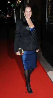 Tracey Emin looked sharp in her blue satin dress and black blazer. She completed her sophisticated look with a gold box clutch.