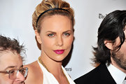 Charlize Theron wore a pop of cool fuchsia lipstick at IFP's 21st Annual Gotham Independent Film Awards.