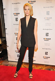 Rachael worked the menswear trend in this slick pantsuit with skinny legs and a boxy vest.