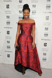Teyonah Parris channeled her inner princess in a red and purple floral off-the-shoulder gown by Cynthia Rowley at the Gotham Independent Film Awards.