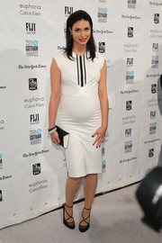 Morena Baccarin attended the Gotham Independent Film Awards wearing a simple white maternity dress with black stripes running down the yoke.