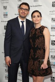 Emmy Rossum sported a perfectly coordinated printed clutch and mini dress combo at the Gotham Independent Film Awards.