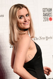 Taylor Schilling has a very simple tattoo of a circle on the right side of her torso.