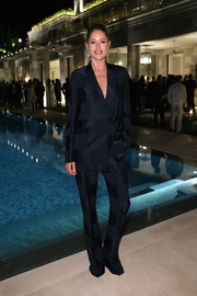 Doutzen Kroes was pajama-chic in a shiny navy pantsuit by Calvin Klein at the Women in Film event in Cannes.